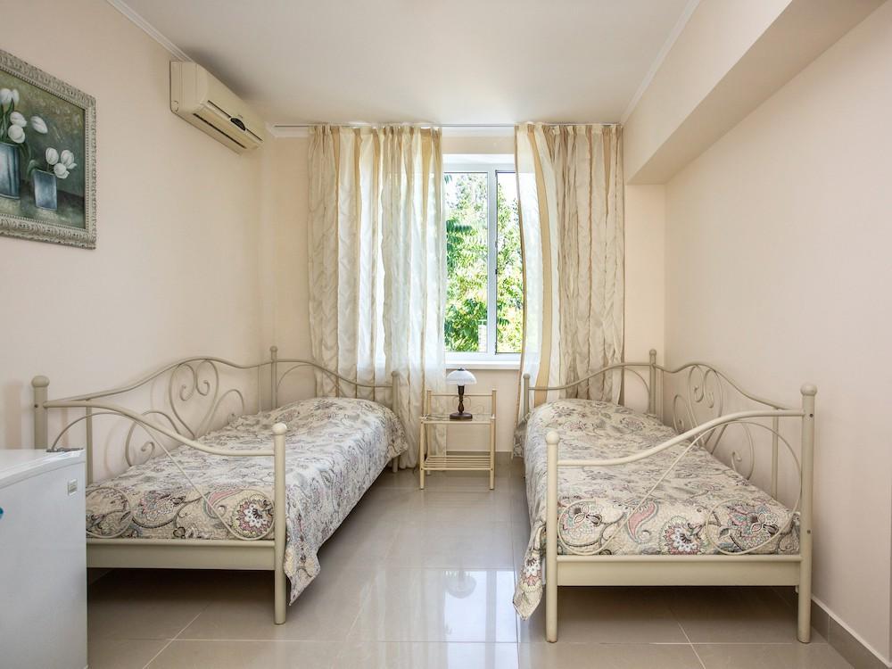 Стандартний номер 2-місний з двома окремими ліжками і терасою